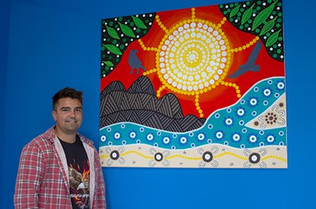 Reconciliation Action Plan Artwork pictured with the artist Billy-Jay O'Toole
