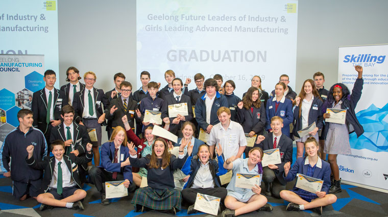 42 students are pictured at their graduation celebration for those who advanced towards their future STEM career